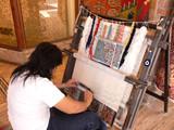 Weaving an carpet.  poster
