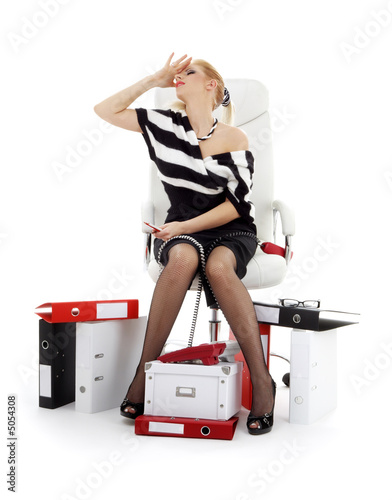 stressed businesswoman in chair over white