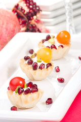 Pomegranates and cream cheese canapes