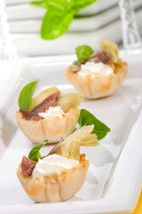 Artichoke, anchovy and cream cheese canapes