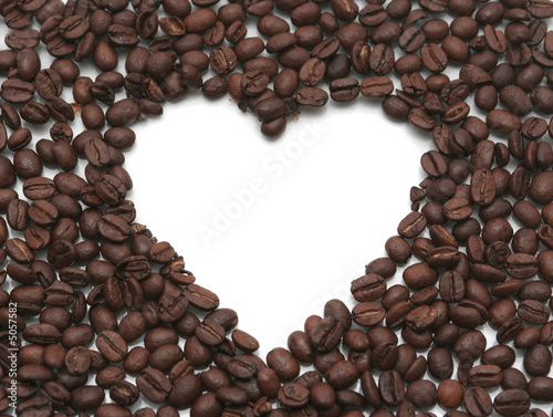 Heart from coffee grains on a white background