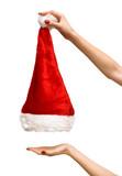 Woman hands lifting up santa hat poster