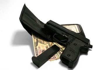 gun with dollar (dollars) and wallet