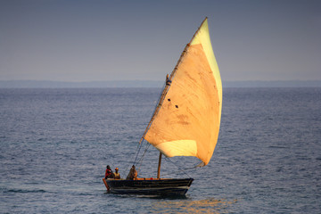 fishing boat sailing on ocean