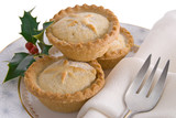 Christmas mince pies on plate with napkin  & holly decoration poster