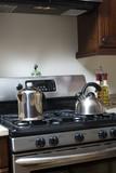 tea pot and coffee pot on stove poster