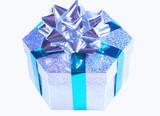 Silver sparkling gift box with green ribbon and silver bow poster