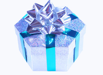 Silver sparkling gift box with green ribbon and silver bow