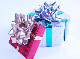 Shiny presents with ribbons and bows on white background.