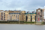 London, converted warehouses on the Thames poster