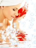 Fototapety lady with red petals and snowflakes in water