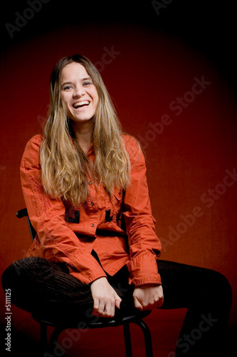 Laughing woman on red