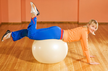 Fitness trainer on a fitball