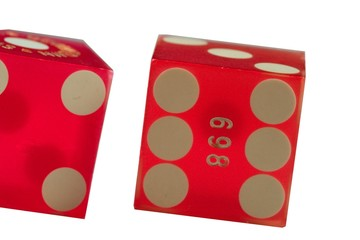 Two red dice close up
