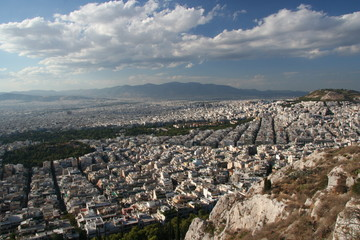 Athens general view from above. Rock, buildings and streets.