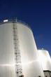 refinery oil tanks and sun-glare