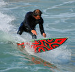 Surfer on Red Board