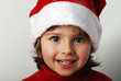 little girl in Santa Claus hat