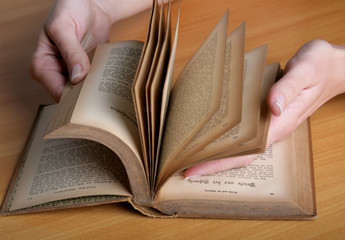 female hands with the book