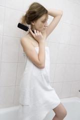 Girl combs hair