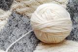 Ball of wool yarn and hand knitting poster