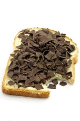 Slice of bread with chocolate flakes  isolated on white