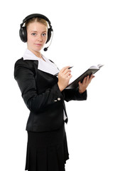 female operator in headset , with notebook  in hands