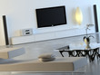 White interior with plasma TV