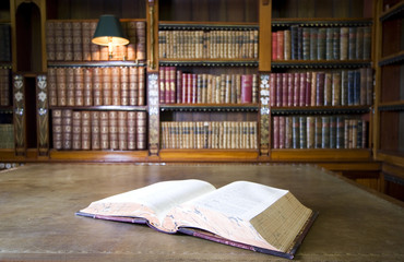 Open book in old ibrary. Part of series