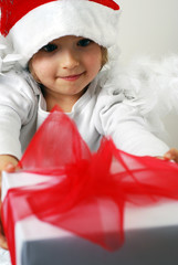 little santa with christmas gift