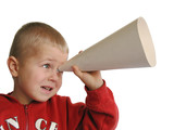 Child looking by telescope poster