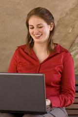studious model works on laptop