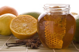 fresh honey with honeycomb, spices and fruits poster