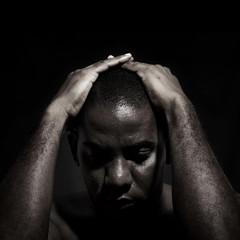 Isolated afroamerican Man in sorrow