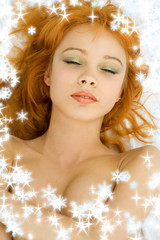 dreaming redhead with snowflakes