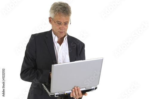 Senior working with laptop