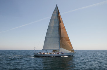 Sailboat with Crew Sitting on Side