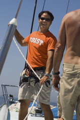 Sailors Working Ropes During Yacht Race