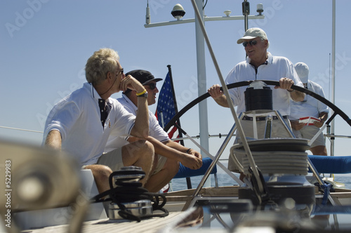 Crew at the Helm During Yacht Race