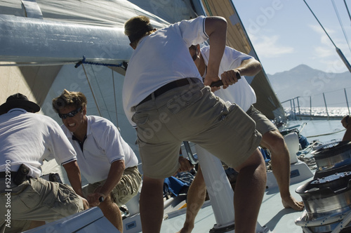 Sailors Raising Sails During Yacht Race