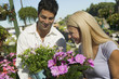 Couple Shopping for flowers in plant nursery