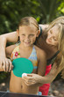 Girl Playing Ping-Pong with Mother