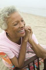 Senior woman smiling at beach, close-up