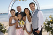 Bride and Groom with family on beach, portrait