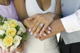 Brides hands and wedding ring, close-up