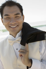 Groom smiling outdoors, close-up, portrait