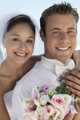 Bride and Groom with bouquet, outdoors, close-up, portrait