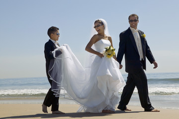 Bride and Groom With Brother on Beach