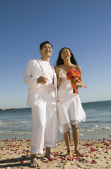 Newly wed couple on beach