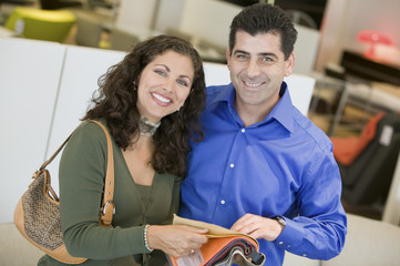 Couple in store looking at Fabric Swatches, portrait
